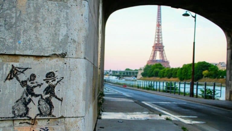 "Banksy ""A couple of rats with an umbrella""at Eiffel Tower in Paris"