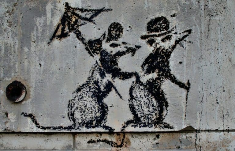 Banksy rat couple with an umbrella