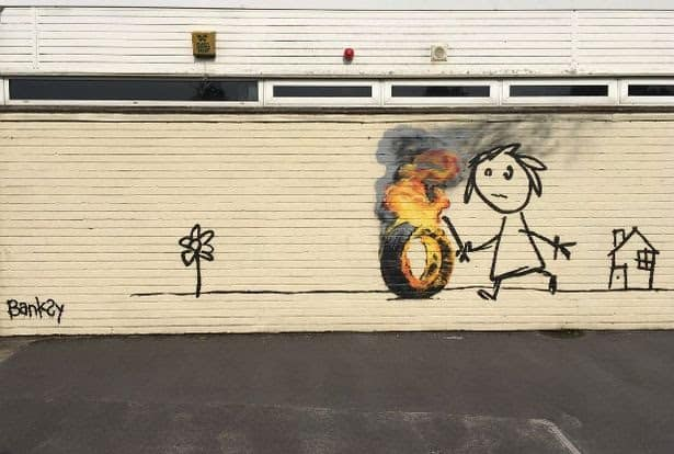 Banksy girl with fire stick at Bridge farm primary school