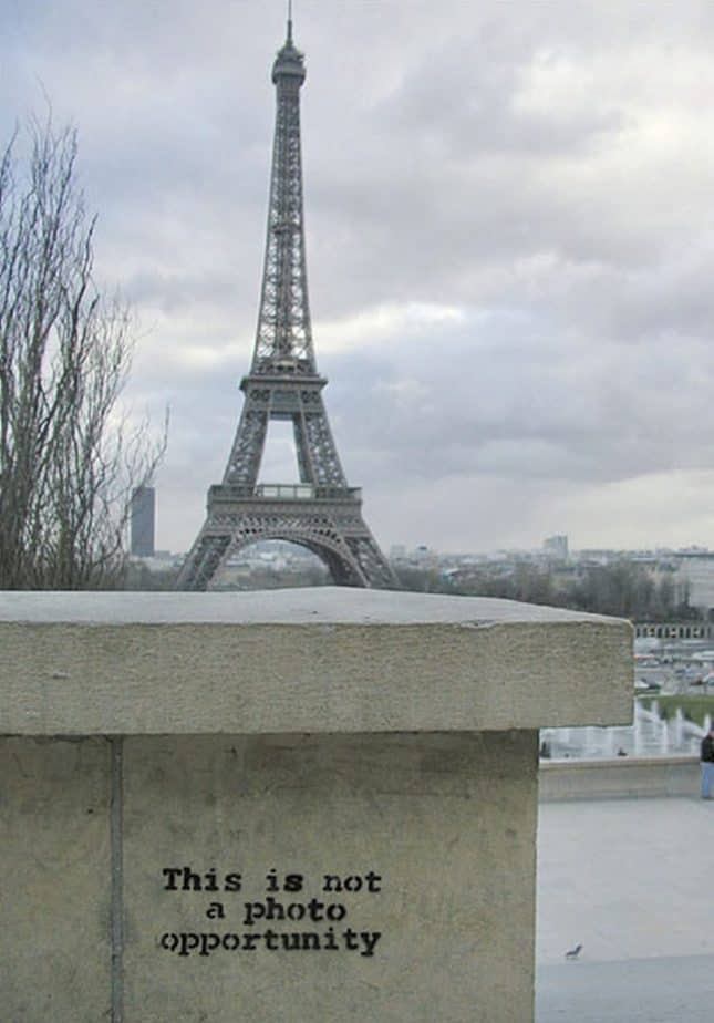 "banksy in paris eiffel tower from palais de chaillot ""This is not a photo opportunity""."