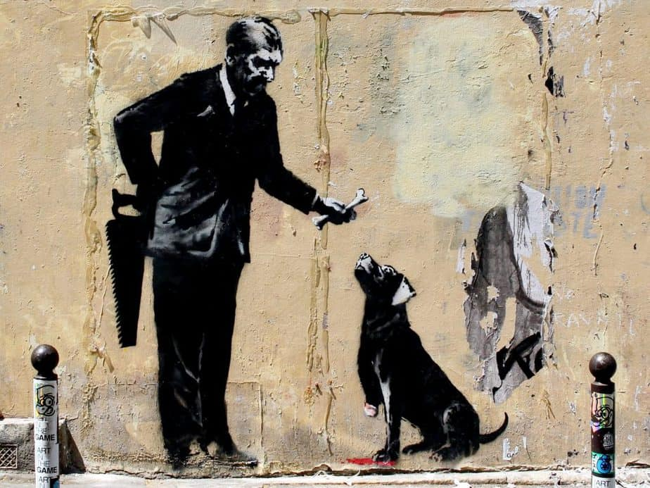 "Banksy ""Dog and businessman in front of the Sorbonne University"""