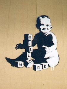 banksy drawing a baby on the wall